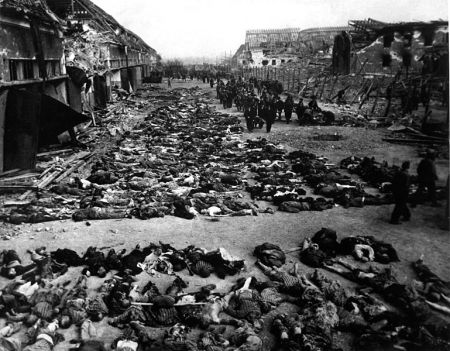 Innumerable bodies draped across the ground of a concentration camp.